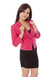 Young business woman standing and smiling.
