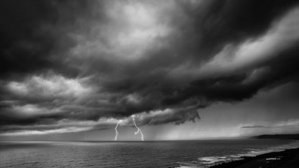 Lightning Storm Over Sea - black and white
