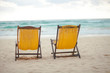 Beach yellow chairs for vacations on tropical beach in Tulum,