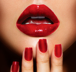 Red Sexy Lips and Nails closeup. Manicure and Makeup
