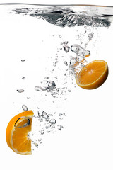 Healthy Water with Fresh Oranges. Splash isolated on white