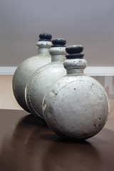 Display of 3 antique metal drug bottles