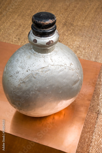 old perfumery bottle on copper occassional table