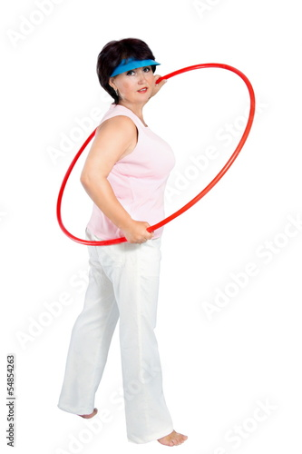 picture of sporty woman with hula hoop