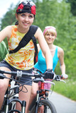 two  young girls on bicycle