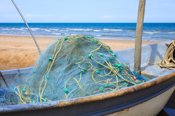 Fishing nets on a boat by the beach