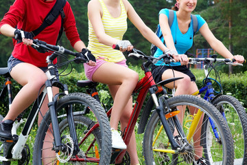 Three  young girls on bicycle