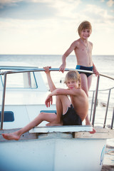 children vacationers by the boat