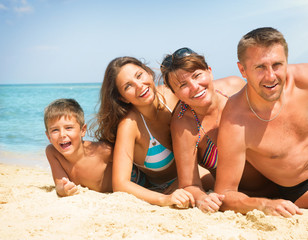Happy Family Having Fun at the Beach. Vacation concept
