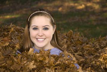 Raking Leaves Girl in Leaf Pile