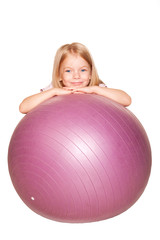 Smiling little girl with fitness ball. Isolated on white