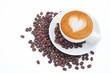 Leinwandbild Motiv A cup of cafe latte and coffee beans on white