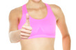 Thumbs up fitness woman in sports bra close up