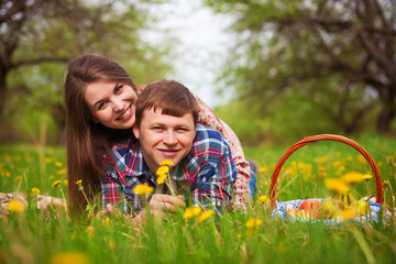 Happy loving couple on a spring meadow
