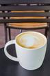 Latte on the black table