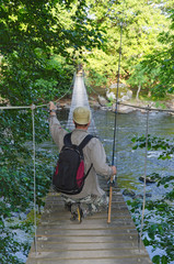 Angler on suspension bridge