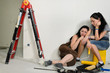 Exhausted female friends doing renovations