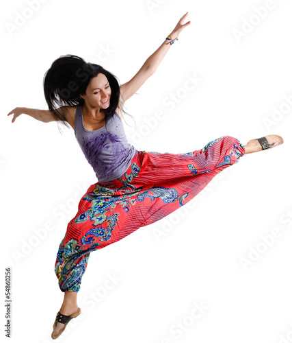 Agile young woman dancing