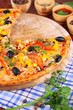 Tasty pizza with kitchen herbs on wooden table close-up
