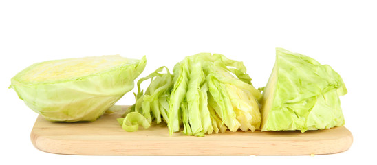 Green cabbage sliced on cutting board, isolated on white