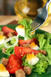 Fresh mixed salad with eggs, tomato, salad leaves and other