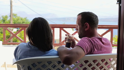 Couple in love talking and relaxing on beautiful terrace