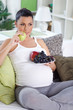 Pregnant woman eating fresh fruits