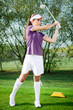 Girl golfer hitting the ball