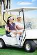 Couple in golf buggy