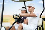 Couple in golf car