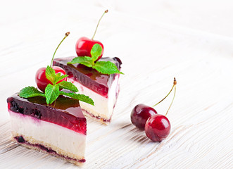 Cherry cheesecake with tea on a wooden table