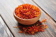 Saffron in wooden bowl - 54871699
