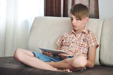 Boy using a tablet computer
