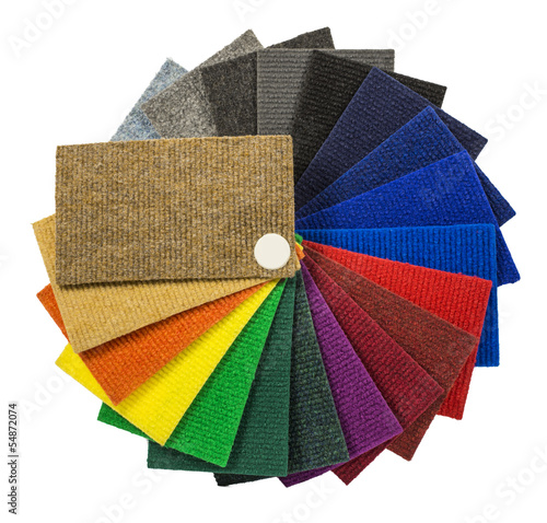 Multi-colored carpeting samples by a fan - 54872074