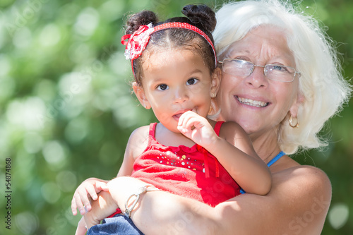 Caucasian grandmother and her latin granddaughter