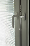 Closed blinds and window handles