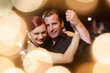Tango couple in sparkling bokeh lights