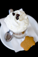 Delicious coffee with whipped cream and cookies