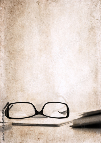artwork  in vintage  style,  textbook, glasses and cup of coffee
