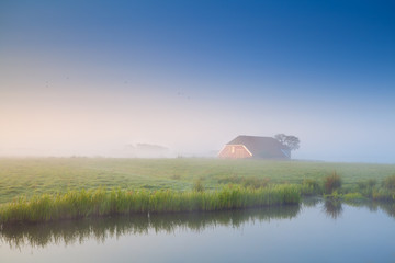 little house in morning fog
