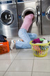 Woman Searching Clothes In Washing Machine Drum