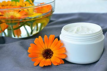Calendula cosmetic cream and flowers