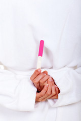 woman hiding pregnancy test