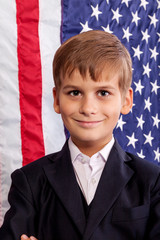 Portait of Caucasian boy with American flag