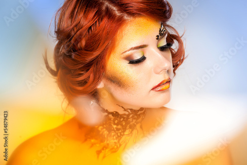 pretty woman with beautiful fantasy make-up - beauty shot