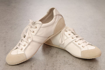 pair of white gym-shoes