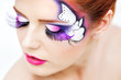 pretty woman with beautiful fantasy make-up - beauty shot