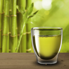 Glass of green tea with bamboo background