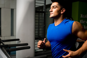 Running on treadmill in gym