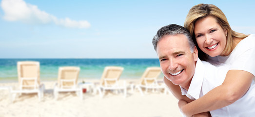 Happy senior couple on a tropical beach.